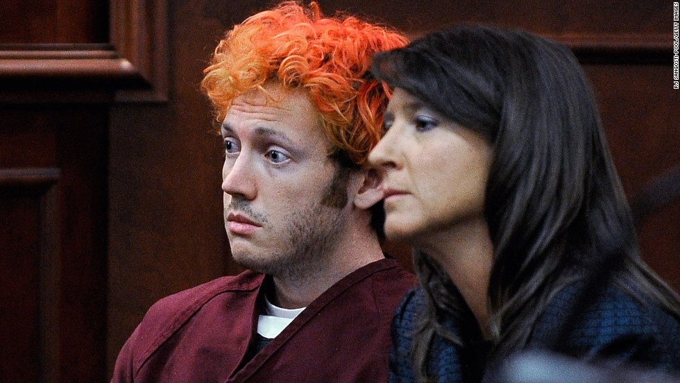 "The public gets its first glimpse of James Holmes, then 24, the suspect in the Colorado theater shooting during his initial court appearance July 23, 2012. With his hair dyed reddish-orange, Holmes, here with public defender Tamara Brady, showed little emotion. He is accused of opening fire in a movie theater July 20, 2012, in Aurora, Colorado, killing 12 people and wounding 70. Holmes faces 166 counts, almost all alleging murder or attempted murder. He has pleaded not guilty by reason of insanity. <a href=""http://www.cnn.com/2012/07/21/us/gallery/colorado-mourning-victims/index.html"" target=""_blank"">More photos: Mourning the victims of the Colorado theater massacre</a>"