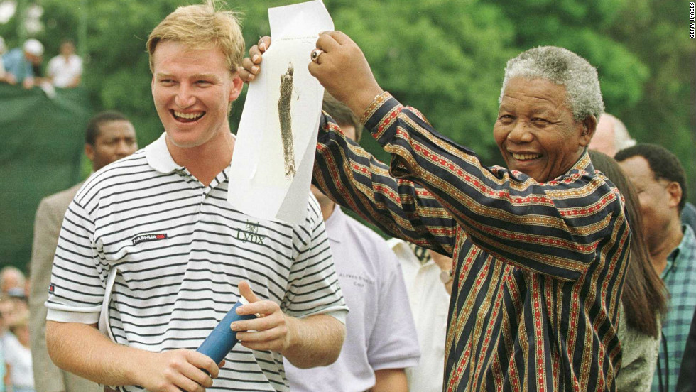 Els was the first South African golfer to win a major title after Mandela came to power in 1994. They are seen here before the final round of the 1996 South African PGA Championship.