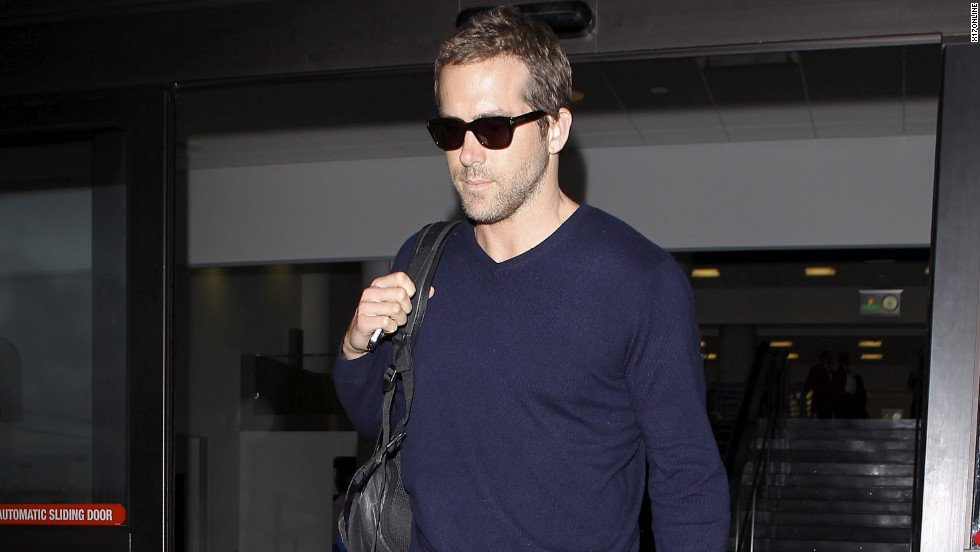 Ryan Reynolds leaves the airport.