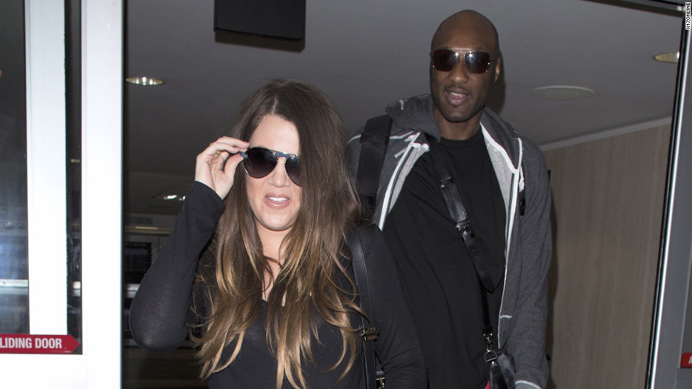 Khloe Kardashian and Lamar Odom arrive in Los Angeles.