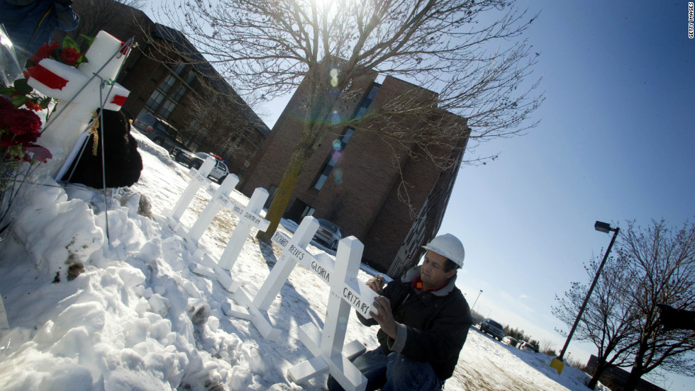 Zanis says he has created more than 13,000 crosses for people across the country. Here, he puts the names of victims of a hotel shooting on crosses in Brookfield, Wisconsin, in 2005.