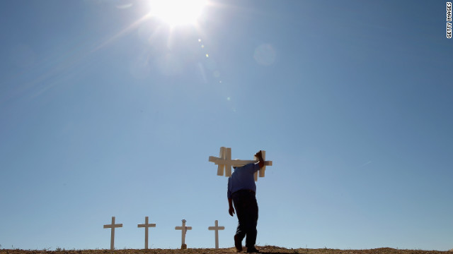 After mass tragedies, this carpenter builds crosses to help a nation grieve
