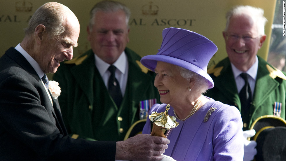 Britain's Queen Elizabeth is a renowned racehorse owner, with her first victory coming in her Coronation year of 1953 when Choir Boy won at Ascot. She is pictured here collecting the Queen's Vase after her horse Estimate triumphed at  Royal Ascot this year -- her 21st win at the prestigious meeting.