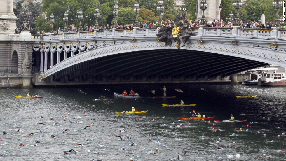 At the same 1900 Olympics, obstacle course swimmers had to negotiate boats and poles. Today the River Seine is more likely to accomodate triathletes in the city's annual competition.