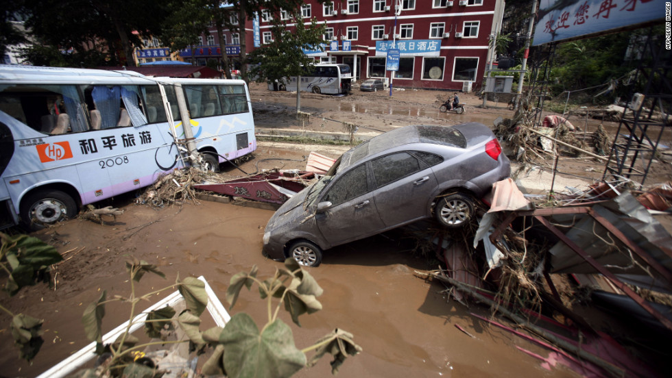 Weekend flooding leaves vehicles tossed about on roads in Laishui, a town in northern China's Hebei province.