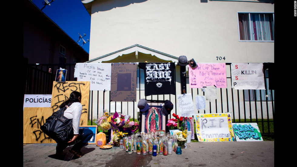 An Anaheim resident pauses at a memorial for Diaz on July 24.