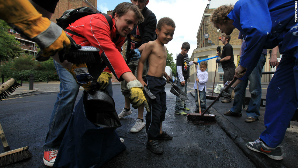 But the day after, when hundreds of volunteers turned up with brooms to help clean up east London's broken neighborhoods, showed an extraordinary sense of community.