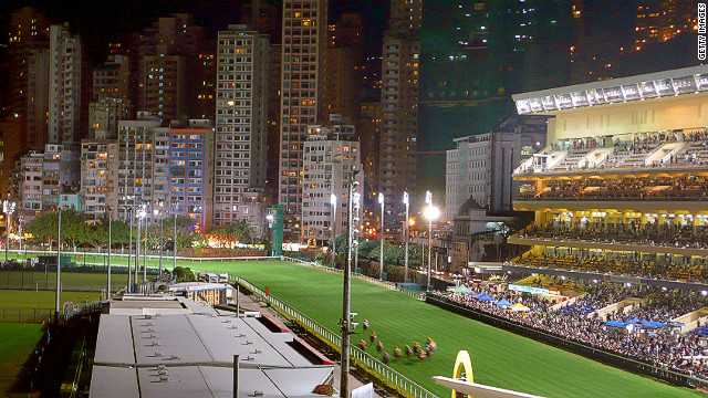 Happy Valley Racecourse is surrounded by giant apartments and skyscrapers.