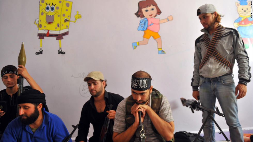 Fighters from the Syrian opposition rest at a former primary school in Aleppo on Wednesday.