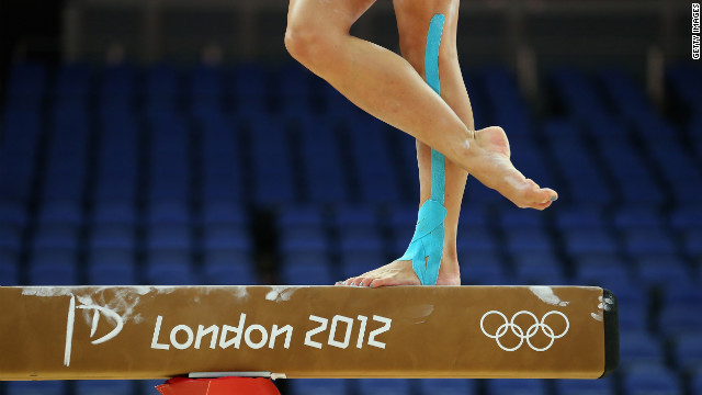 LONDON, ENGLAND - JULY 26:  A gymnast practices on the balance beam during training sessions for artistic gymnastics ahead of the 2012 Olympic Games at Greenwich Training Academy on July 26, 2012 in London, England.  (Photo by Ronald Martinez/Getty Images)
