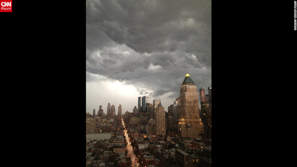 Dark clouds hang over Manhattan on Thursday, July 26, in this photo from iReporter Thomas Piercy.