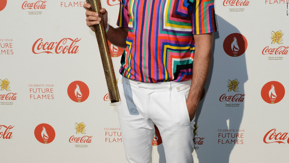 Mark Ronson holds the torch backstage at the 2012 Olympic Torch Relay Finale Concert in London on July 26.