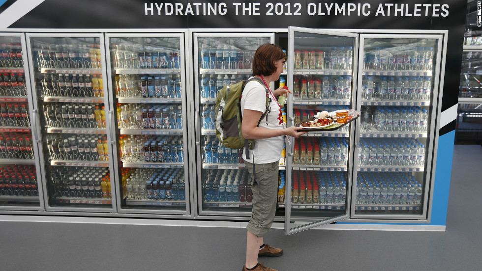 A Canadian team member takes a drink from a refrigerator in the main dining hall in the Olympic Village ahead of the Games on July 24.