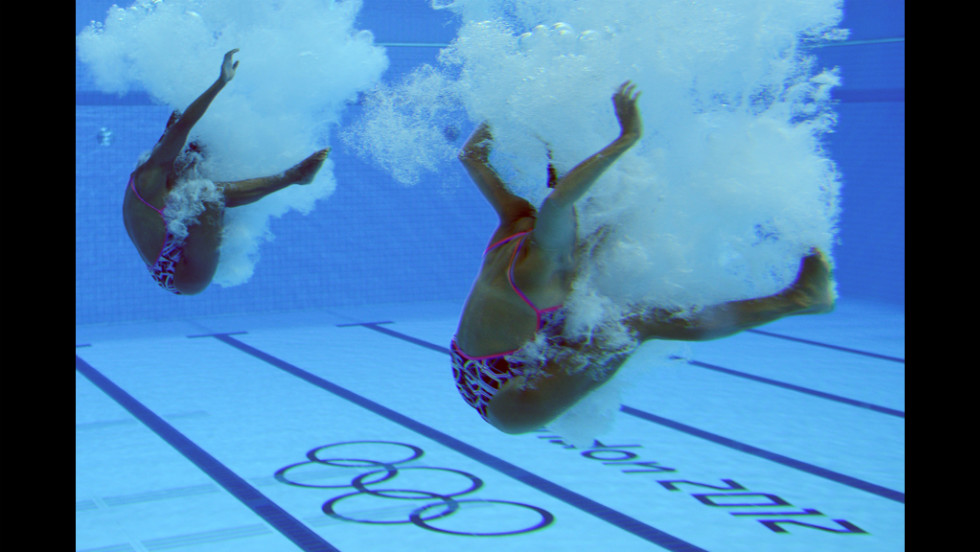 Olympians will compete over anything. Here, two divers have an exhaling contest.
