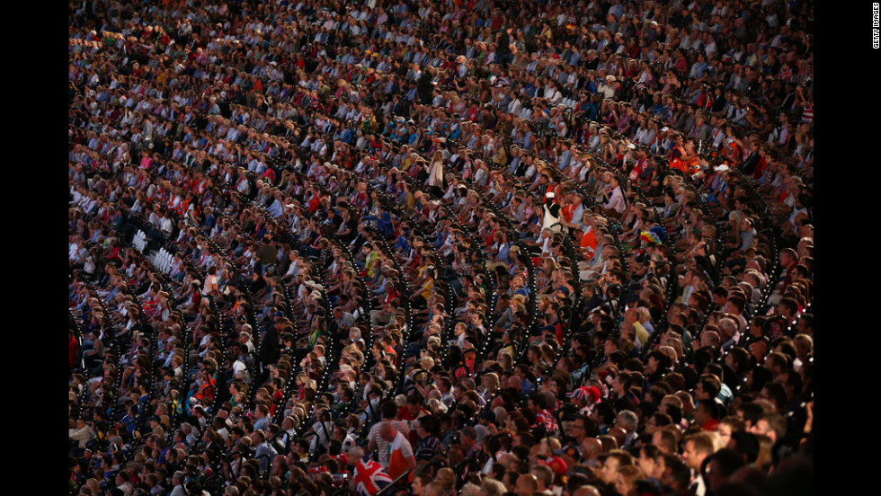 Spectators watch the Opening Ceremony of the London 2012 Olympic Games.