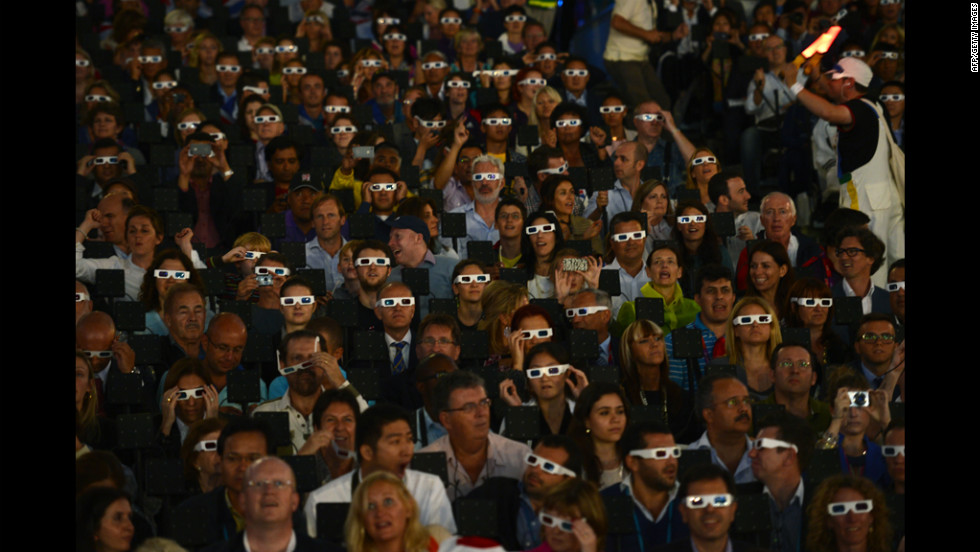 Spectators wearing 3-D glasses during the opening ceremony.