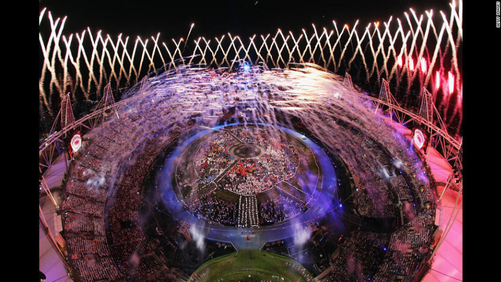Fireworks light up the Olympic Stadium and the night sky.