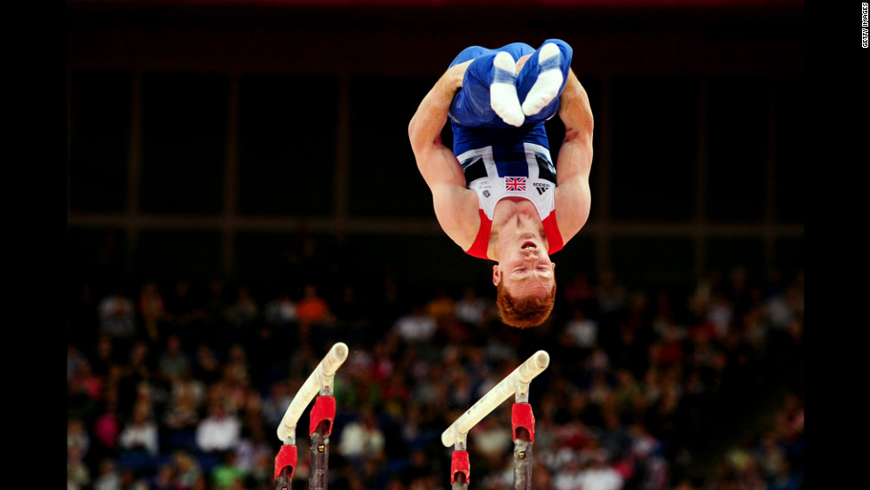 British gymnast Daniel Purvis performs on the artistic gymnastics men's parallel bars.