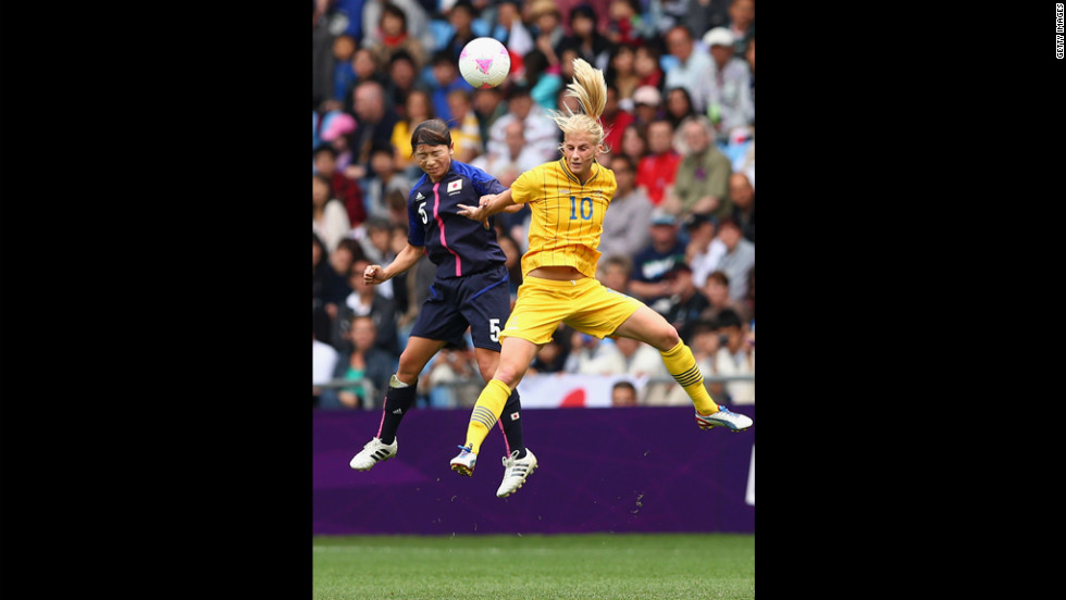 Japan's Aya Sameshima and Sofia Jakobsson of Sweden compete for the ball during a women's first-round soccer game.