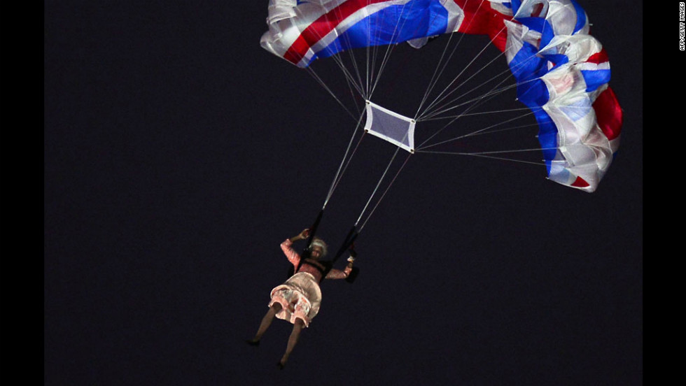 An actor dressed to resemble Britain's Queen Elizabeth II parachutes into the stadium during the opening ceremony.