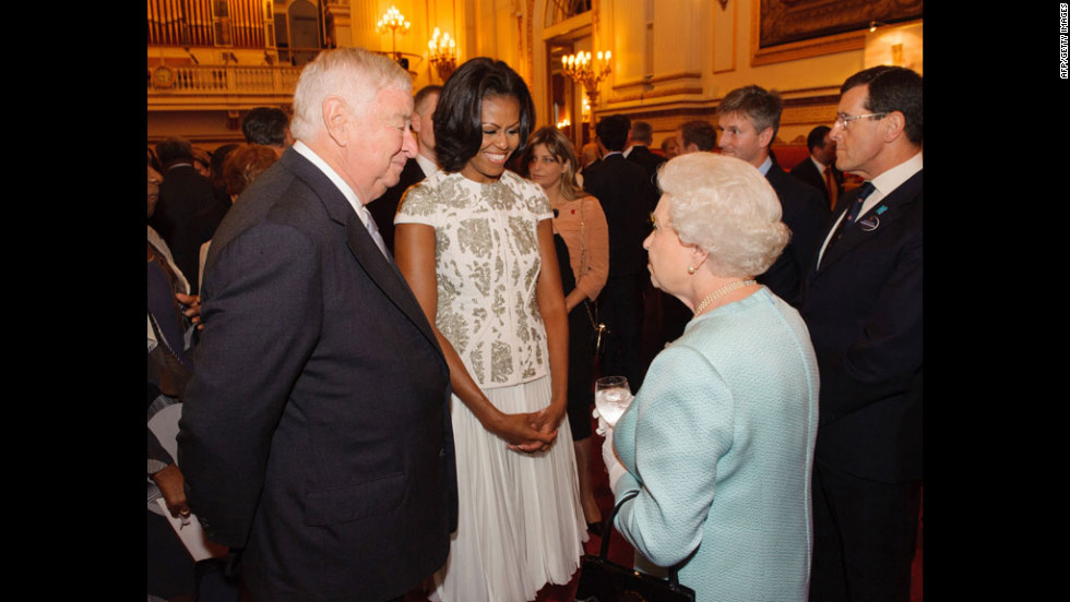 Queen Elizabeth II talks with U.S. first lady Michelle Obama and U.S. Ambassador Louis Susman during a reception Buckingham Palace for visiting heads of state and other national representatives before they travel to London's Olympic Stadium to attend the opening ceremony of the 2012 Summer Games.