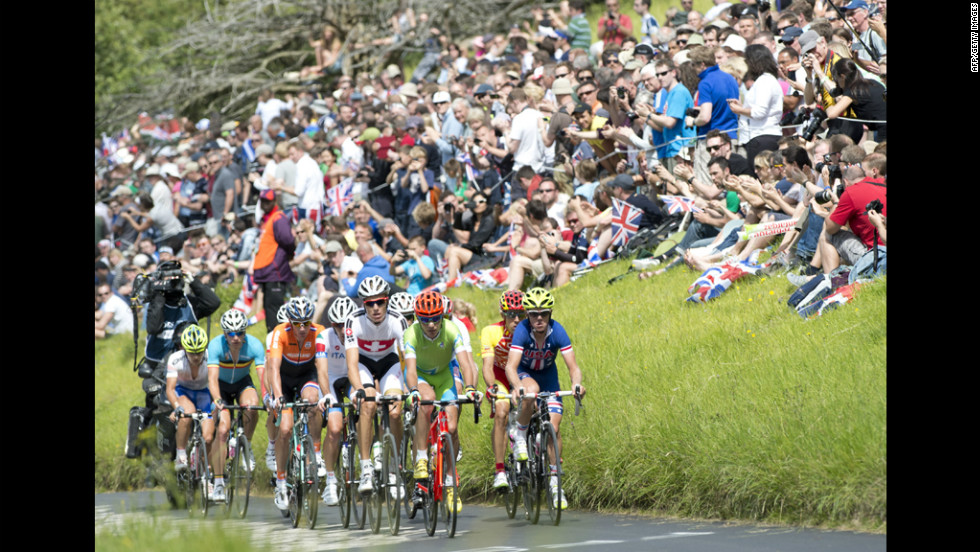 Spectators applaud as the peleton rides up Boxhill on the outskirts of London during the men's cycling road race.