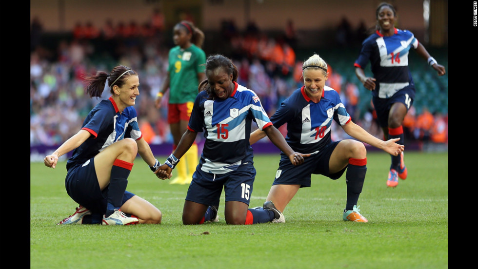 Jill Scott, left, of Great Britain celebrates scoring with teammates Eniola Aluku and Kelly Smith during a first-round women's soccer game against Camaroon.
