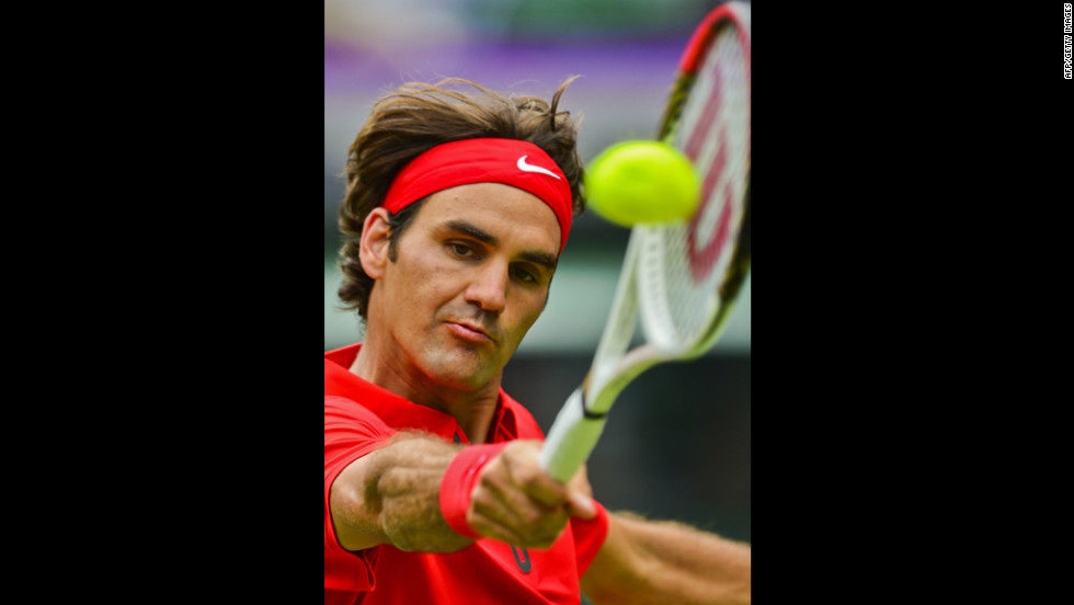 Switzerland's Roger Federer returns the ball to Colombia's Alejandro Falla during the men's singles tennis match.