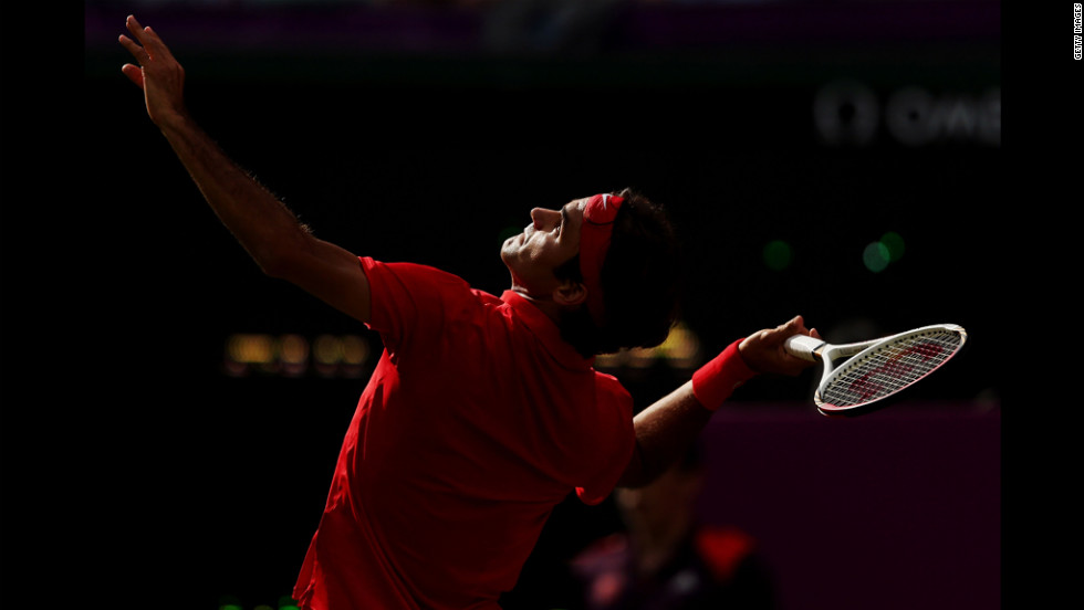 Roger Federer of Switzerland serves against Alejandro Falla of Colombia during their men's singles tennis match.