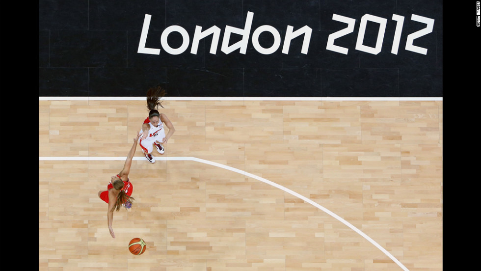 Sue Bird, No. 6, of the United States shoots against Iva Ciglar, No. 10, of Croatia in the first half of their women's basketball game.