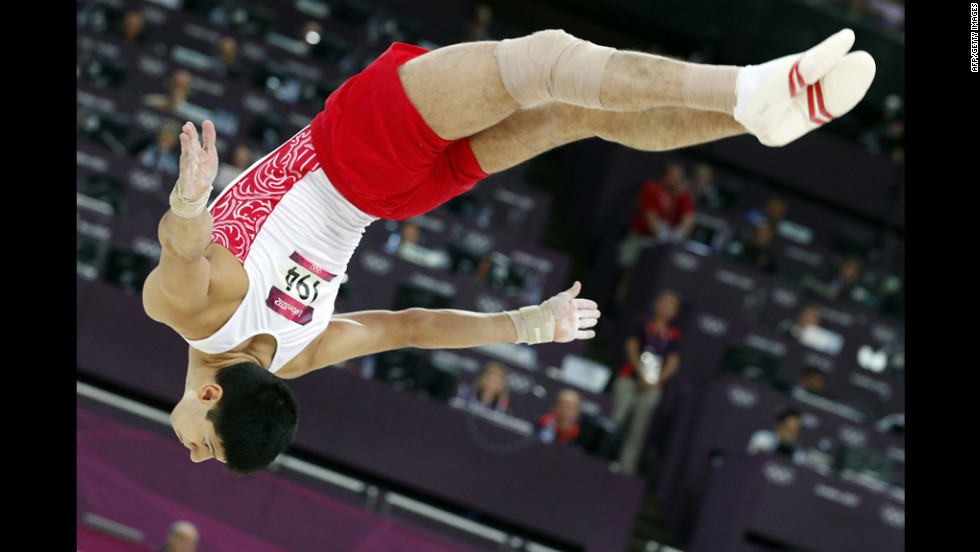 Russian gymnast Emin Garibov in the air during the men's artistic gymnastics qualification.