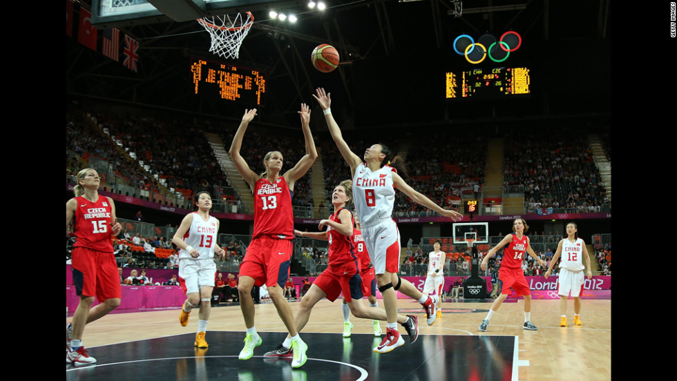 Lijie Miao of China, No. 8, battles for the basketball against Petra Kulichova, No. 13, of Czech Republic.