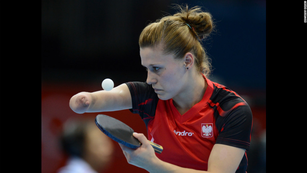 Poland's Natalia Partyka serves during a preliminary-round singles match against Denmark's Mie Skov in women's table tennis.