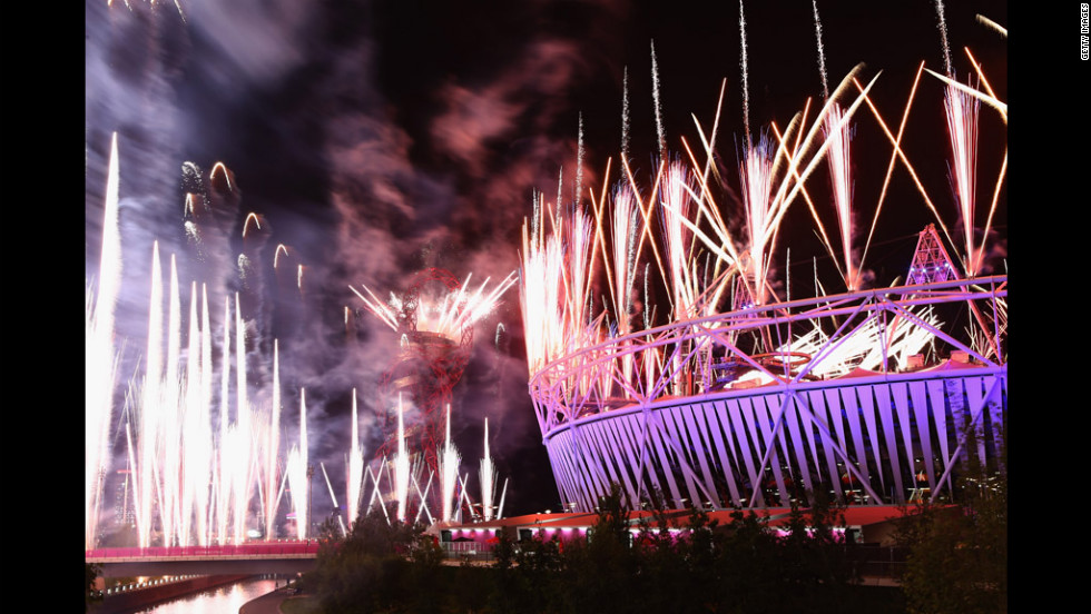 Fireworks cast a purple glow over the Olympic Stadium.