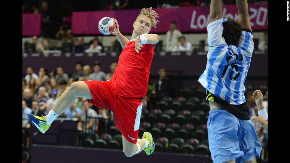 Aron Palmarsson of Iceland jumps to shoot during the men's preliminaries handball match against Argentina.