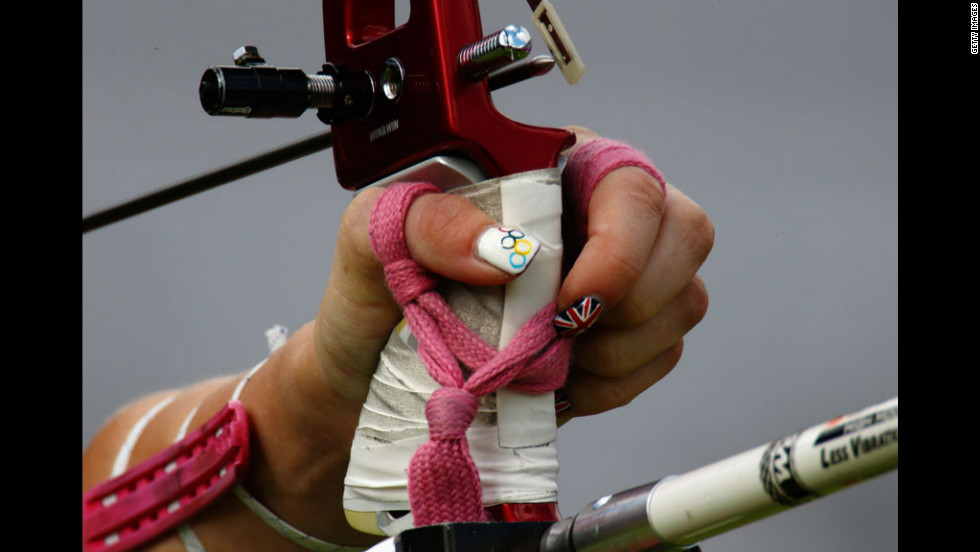 The festive nail polish of Great Britain's Amy Oliver stands out during the women's team archery elimination match between Britain and Russia.