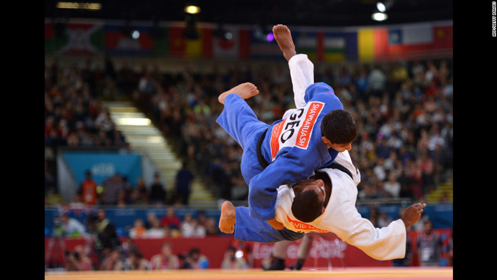 France's David Larose, in white, and Lasha Shavdatuashvili of Georgia, in blue, face off during the men's half lightweight judo event.