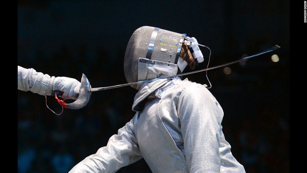 Dmitry Lapkes, right, of Belarus does battle with Canada's Philippe Beaudry in a fencing bout Sunday at London's ExCeL arena.