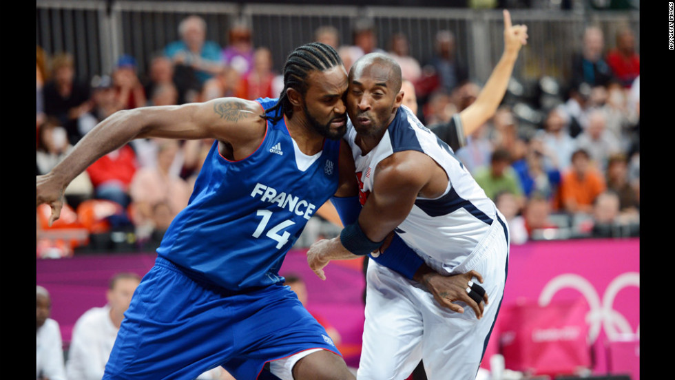 French center Ronny Turiaf challenges U.S. guard Kobe Bryant during the men's preliminary round Group A match.
