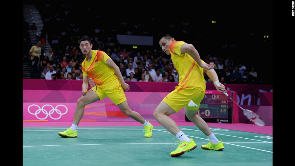 China's Biao Chai, right, and Zendong Guo return a shot against South African competitors during a men's doubles badminton match at Wembley Arena.