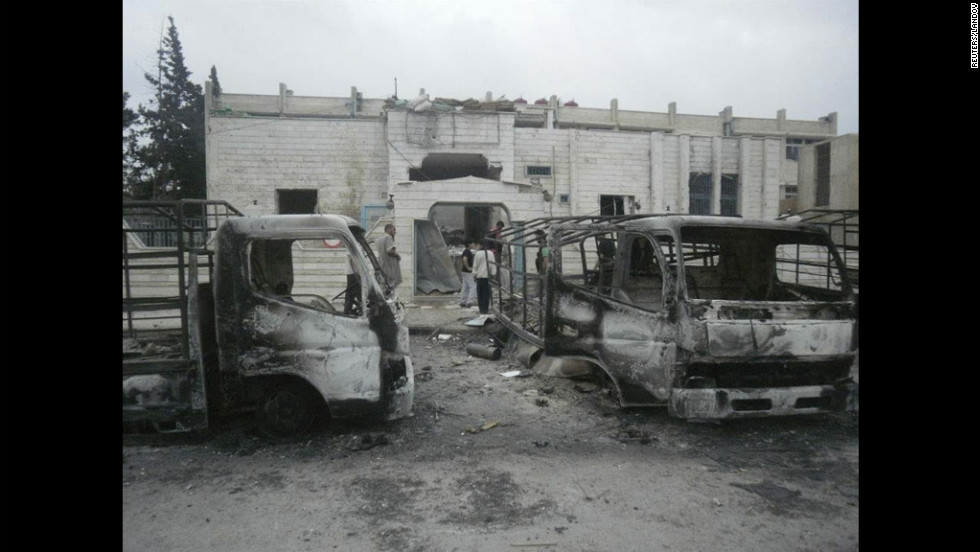 Fighting leaves vehicles damaged Saturday in the southwestern city of Daraa.