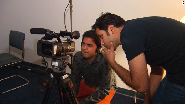 Mujeeb Arez, left, and Taimor Najib check the inputs on their camera before getting to workk.