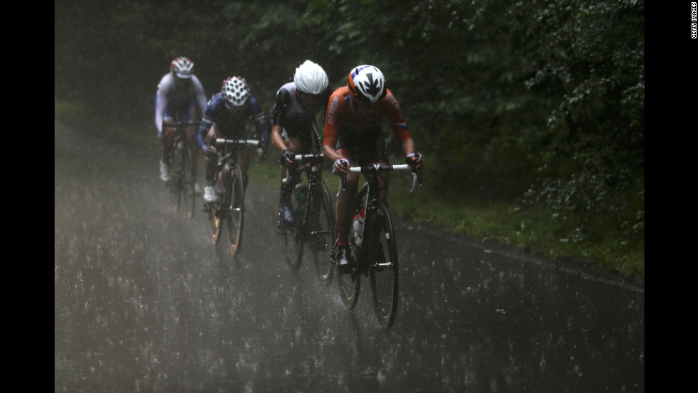 From right, Marianne Vos of the Netherlands, Elizabeth Armitstead of Great Britain, Kristin Armstrong of the United States and Olga Zabelinskaya of Russia cycle in a downpour during the women's road race.