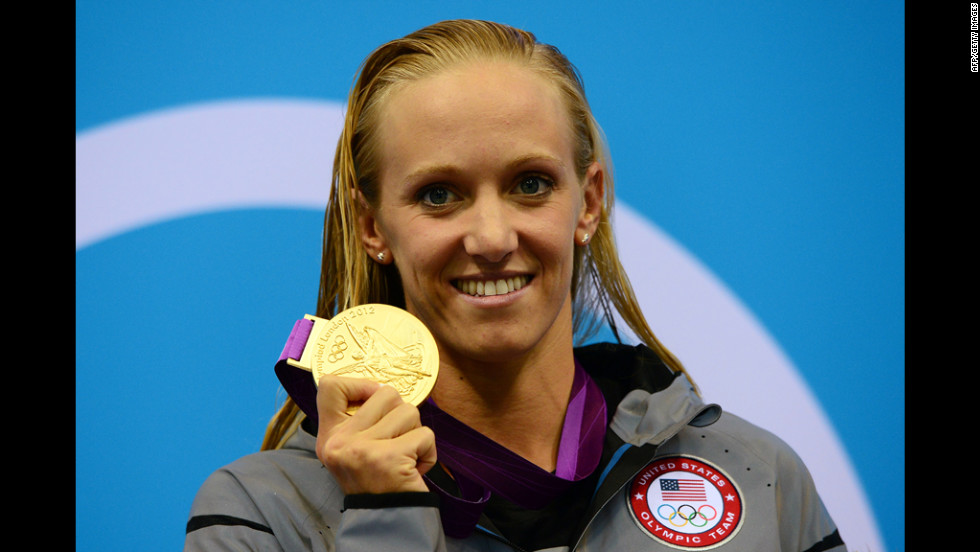 U.S. swimmer Dana Vollmer poses on the podium after winning a gold medal in the women's 100-meter butterfly final at the London Olympics on Sunday, July 29.