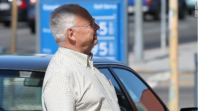 A customer pumps gas at a station Friday in San Rafael, California.