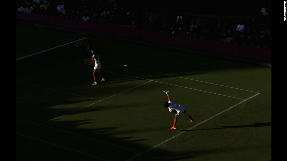Sania Mirza of India serves during her women's doubles tennis match with Rushmion Chakarvarthi against Chia-Jung Chuang and Su-Wei Hsieh of Taiwan.