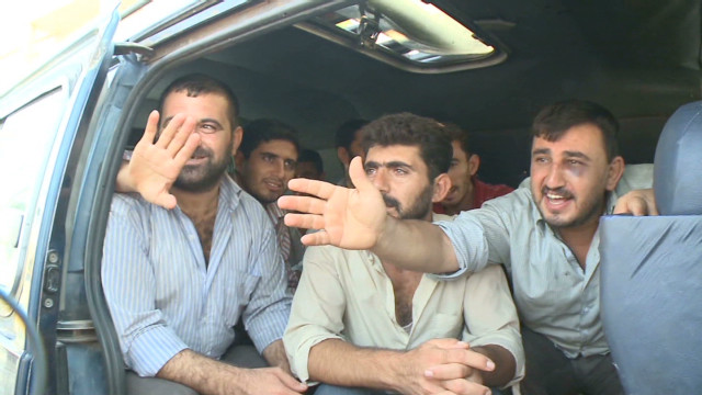 Watch a prisoner exchange in Syria