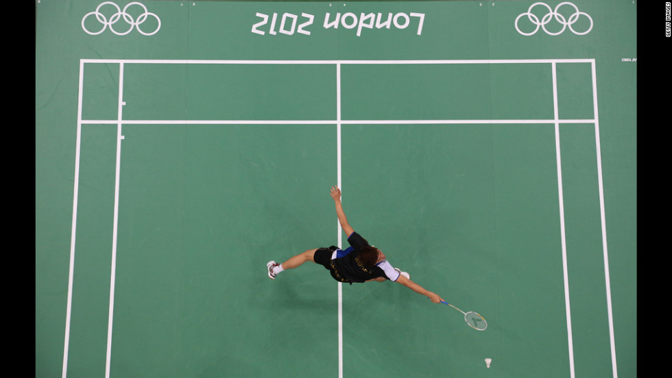 Lee Yong-Dae of South Korea reaches for a shot during the mixed doubles badminton match against Thomas Laybourn and Kamilla Rytter Juhl of Denmark on Monday.