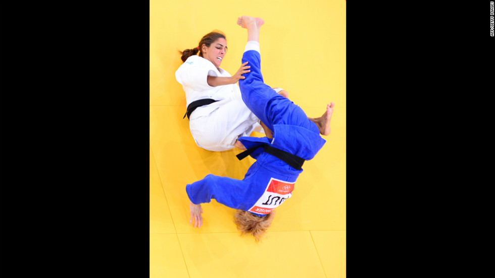 Italy's Giulia Quintavalle, in white, competes with Australia's Carli Renzi during the women's 57-kilogram judo contest Monday.