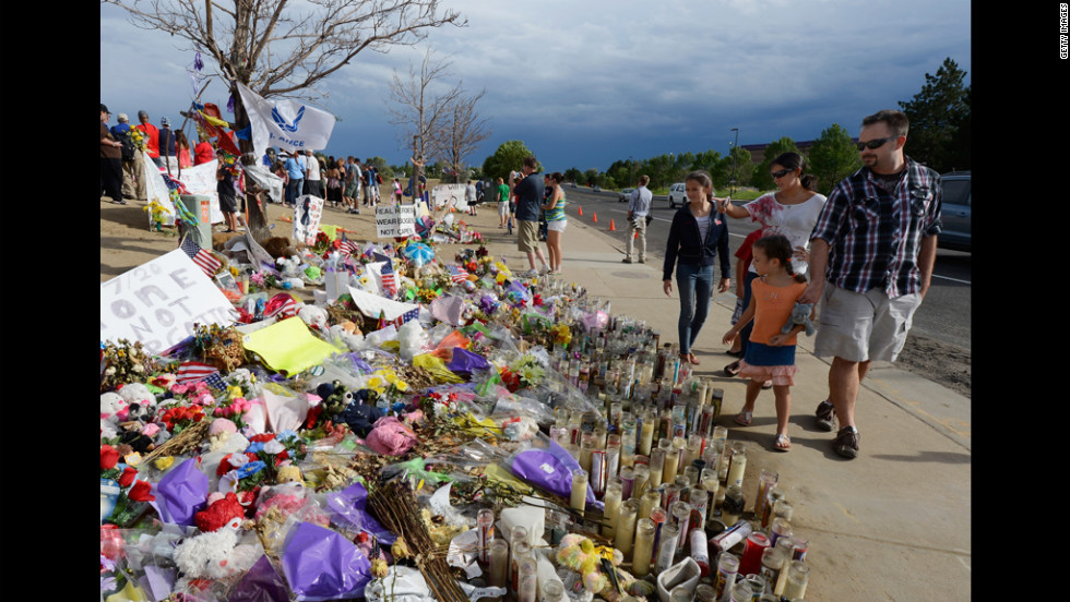 People visit the roadside memorial set up for victims of the massacre on Monday.